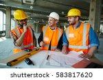team of cheerful construction... | Shutterstock . vector #583817620