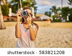 woman taking photo on beach in... | Shutterstock . vector #583821208