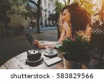 young curly woman talking in... | Shutterstock . vector #583829566