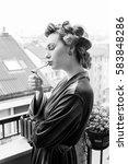 beautiful girl smokes a... | Shutterstock . vector #583848286