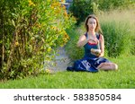 a girl in blue dress with yoga... | Shutterstock . vector #583850584