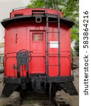 Bright Red Caboose At The Rear...