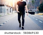 young muscular man wearing... | Shutterstock . vector #583869130