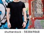 young muscular man wearing... | Shutterstock . vector #583869868