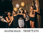 group of women with fireworks... | Shutterstock . vector #583875193