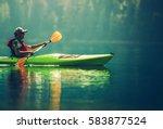 Senior Kayaker On The Lake....