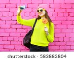 fashion smiling girl taking... | Shutterstock . vector #583882804