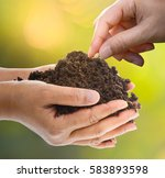 hand planting a seed in soil ... | Shutterstock . vector #583893598