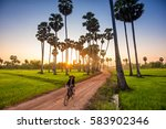 woman riding bicycle to go home ... | Shutterstock . vector #583902346