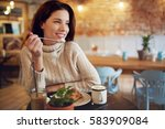 woman in a cafe drinking coffee | Shutterstock . vector #583909084