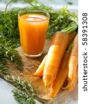 glass of fresh carrot juice and some fresh vegetables - stock photo