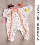Small photo of Romper for baby. Clothes for children from delicate jersey. View from above. Romper for babies from environmentally friendly fabrics. Romper for an infant
