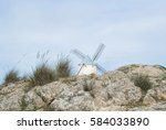 white old windmill on the hill... | Shutterstock . vector #584033890