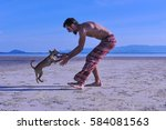 happy man play with your dog on ... | Shutterstock . vector #584081563