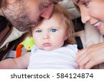 baby parents family attention... | Shutterstock . vector #584124874