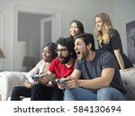Small photo of Friends playing a video game