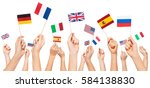 hands holding flags of usa and... | Shutterstock . vector #584138830