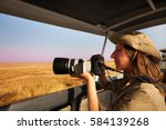 woman taking photo aboard... | Shutterstock . vector #584139268