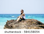 i sit on the rocks overlooking... | Shutterstock . vector #584158054