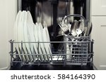 clean cutlery and plates after... | Shutterstock . vector #584164390