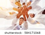 many happy doctors stack hands... | Shutterstock . vector #584171068