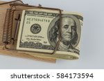 dollar bills in mouse trap | Shutterstock . vector #584173594