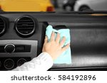 closeup of woman cleaning a car ...   Shutterstock . vector #584192896