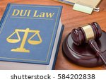 a law book with a gavel   dui...   Shutterstock . vector #584202838
