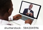 african man taking a webinar... | Shutterstock . vector #584204596