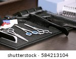 instruments for cutting hair in ... | Shutterstock . vector #584213104