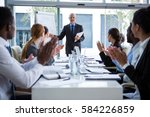 businesspeople applauding on... | Shutterstock . vector #584226859