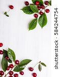 fresh ripe cherry with green... | Shutterstock . vector #584244754
