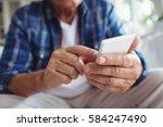 mid section of senior man using ...   Shutterstock . vector #584247490
