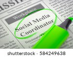 Stock photo social media coordinator newspaper with the classified advertisement of hiring circled with a 584249638