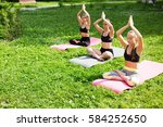 group women practicing yoga in... | Shutterstock . vector #584252650