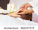 woman receiving a hand massage... | Shutterstock . vector #584257579