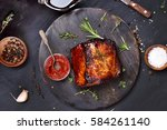 barbecue pork  grilled meat on...   Shutterstock . vector #584261140
