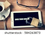 tablet and padlock on the... | Shutterstock . vector #584263873