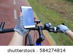 cyclist hands use gps navigator ... | Shutterstock . vector #584274814