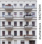white building facade with... | Shutterstock . vector #584276044