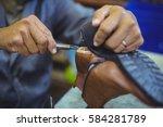 shoemaker repairing a shoe sole ... | Shutterstock . vector #584281789