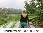 young blonde woman travelling... | Shutterstock . vector #584283820