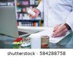 pharmacist writing... | Shutterstock . vector #584288758