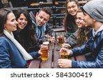 group of friends enjoying a... | Shutterstock . vector #584300419