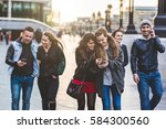 multiracial group of friends... | Shutterstock . vector #584300560