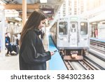 girl with smart phone at train... | Shutterstock . vector #584302363