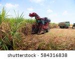 sugarcane harvester machine | Shutterstock . vector #584316838
