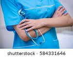 mid section of nurse standing... | Shutterstock . vector #584331646