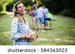 woman playing drums having bbq  ... | Shutterstock . vector #584363023