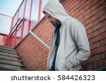 Lonely Man Leaning against an urban wall